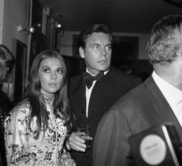 American actors Natalie Wood and Robert Wagner who were married for the second time earlier this year are pictured at the Paris Olympia music-hall on Sept. 19, 1972 when they attended the premiere of the new show of French singer Sylvie Vartan. (AP Photo/MIC)