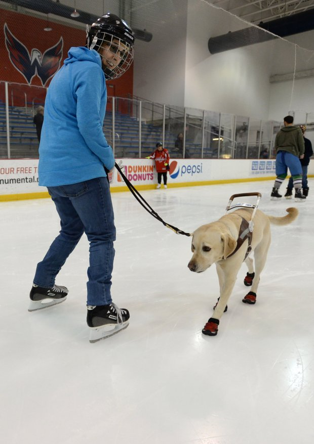 Emily Molchan skates with guide dog Remington at a skating session inJanuary. MUST CREDIT: Photo for The Washington Post by Essdras M Suarez