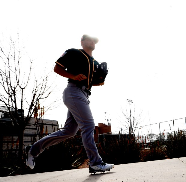 Oakland Athletics pitcher Kendall Graveman runs to a field at the Lew Wolff Training Complex on Sunday, Feb. 18, 2018, in Mesa, Ariz. (Aric Crabb/Bay Area News Group)
