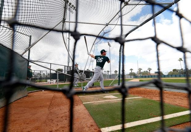 Oakland Athletics third baseman Matt Chapman takes part in batting practice at the Lew Wolff Training Complex on Monday, Feb. 19, 2018, in Mesa, Ariz. (Aric Crabb/Bay Area News Group)