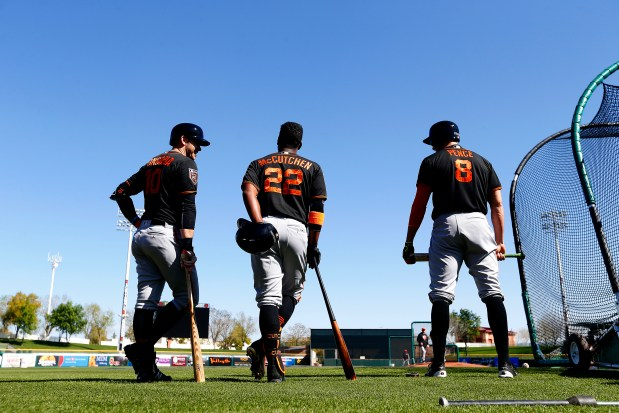 San Francisco Giants Evan Longoria, left, Andrew McCutchen, center, and Hunter Pence, right, take part in batting practice during spring training workouts on Tuesday, Feb. 20, 2018, in Scottsdale, Ariz. (Aric Crabb/Bay Area News Group)