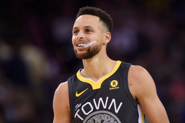 Golden State Warriors' Stephen Curry (30) smiles while playing the Dallas Mavericks during the second quarter of their NBA game at the Oracle Arena in Oakland, Calif., on Thursday, Feb. 8, 2018. (Jose Carlos Fajardo/Bay Area News Group)