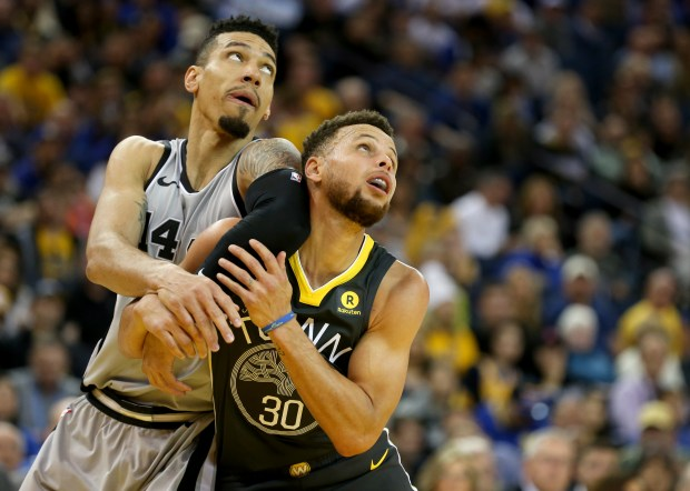 Golden State Warriors' Stephen Curry (30) and San Antonio Spurs' Danny Green (14) battle for position under the basket in the third period of a NBA game at Oracle Arena in Oakland, Calif., on Saturday, Feb. 10, 2018. (Anda Chu/Bay Area News Group)