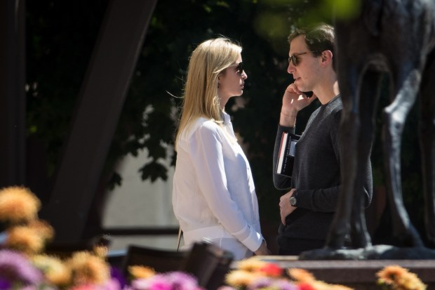 Ivanka Trump and Jared Kushner get an important telephone call on the third day of the annual Allen and Company Sun Valley Conference. (Photo by Drew Angerer/Getty Images)