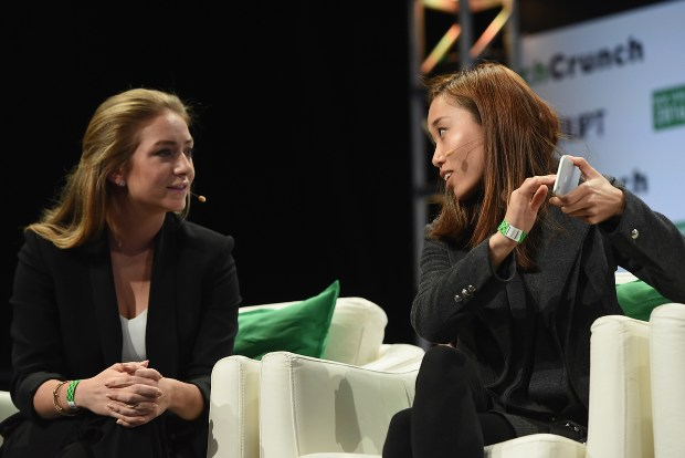 Co-founder and CEO of Bumble Whitney Wolfe and Co-founder and COO of Coffee Meets Bagel Dawoon Kang speak onstage during TechCrunch Disrupt NY 2016 at Brooklyn Cruise Terminal on May 11, 2016 in New York City. (Photo by Noam Galai/Getty Images for TechCrunch)
