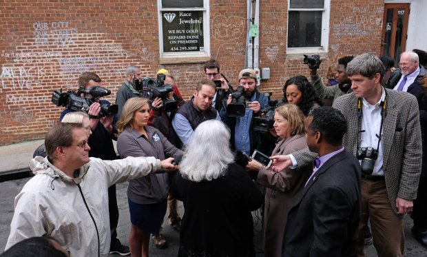 Susan Bro, center with Alfred Wilson, right talk with reporters after aceremony renaming 4th street in Charlottesville, Virginia, in honor of her daughter, Heather Heyer. MUST CREDIT: photo for The Washington Post by Norm Shafer.