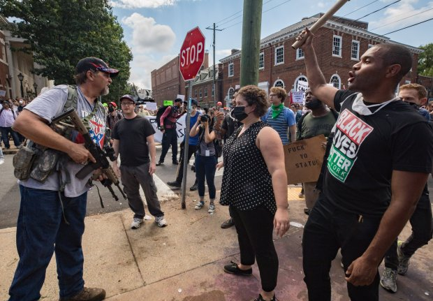 White supremacists and counterprotesters clash at the Unite the Right rallyAug. 12 in Charlottesville, Virginia. MUST CREDIT: photo for The Washington Post by Evelyn Hockstein.