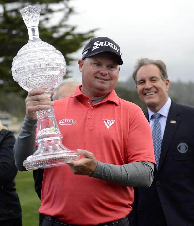 Ted Potter Jr. holds the crystal after winning the AT&T Pebble Beach Pro-Am on Sunday, Feb. 11, 2018. Potter went on to win the tournament by three strokes with a -17. (Vern Fisher - Monterey Herald)