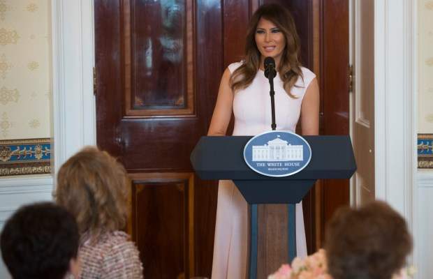 US First Lady Melania Trump speaks as she hosts a luncheon for the spouses of US governors attending the National Governors Association (NGA) winter meeting in the Blue Room of the White House in Washington, DC, February 26, 2018. / AFP PHOTO / SAUL LOEB (Photo credit should read SAUL LOEB/AFP/Getty Images)