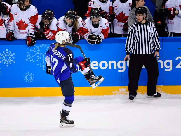 United States' Jocelyne Lamoureux (17) celebrates her game winning shootout goal against Canada during the women's gold medal hockey game at the 2018 Winter Olympics in Gangneung, South Korea, Thursday, Feb. 22, 2018. (Nathan Denette/The Canadian Press via AP)