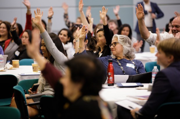 Attendees at the Silicon Valley Council of Nonprofits' Health & Housing Summit raise hands when asked who are working on housing issues or homeless issues or both, during the event on Feb. 2, 2018 in Santa Clara. (Dai Sugano/Bay Area News Group)