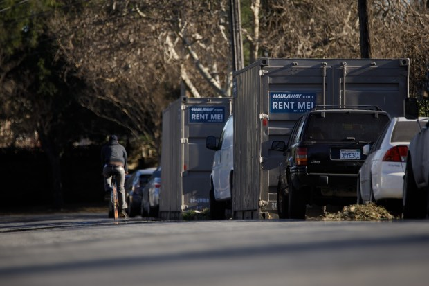 Storage containers holding the belongings of residents affected by the Coyote Creek flood of 2017 line S. 20th Street on Feb. 13, 2018 in San Jose. (Dai Sugano/Bay Area News Group)