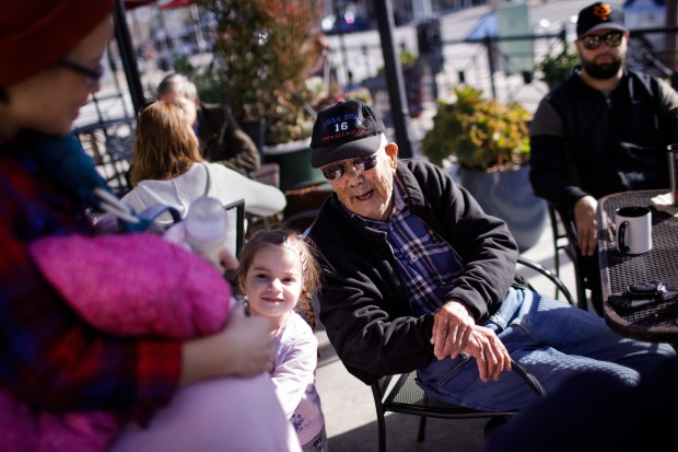 Roy Murotsune, 92, smiles at his great granddaughter, Nahlani, 4, as he and his friends enjoy spending time during their weekly gathering at Roy's Station Coffee & Tea on Jan. 31, 2018. Murotsune ran a gas station which was later turned into the cafe. (Dai Sugano/Bay Area News Group)