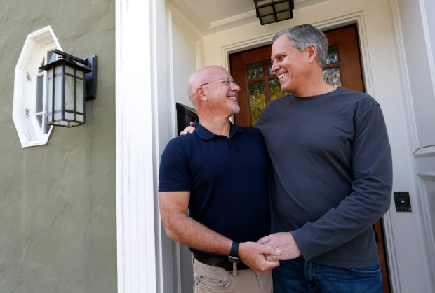Steve Kawa, left, and his husband Dan Henkle are photographed at their home in San Francisco, Calif., on Wednesday, Jan. 31, 2018. The couple were married by now California Lt. Gov. Gavin Newsom in 2004 after Newsom allowed same-sex marriages to go forward in San Francisco while he was mayor. Kawa served as Newsom's chief of staff during this time. (Jane Tyska/Bay Area News Group)