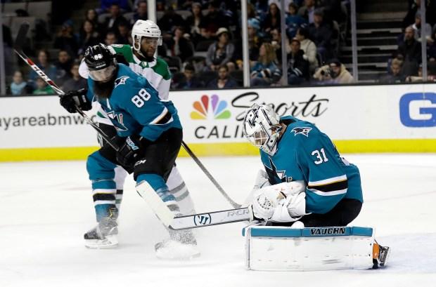 San Jose Sharks goaltender Martin Jones (31) stops a shot by the Dallas Stars during the first period of an NHL hockey game Sunday, Feb. 18, 2018, in San Jose, Calif. (AP Photo/Marcio Jose Sanchez)