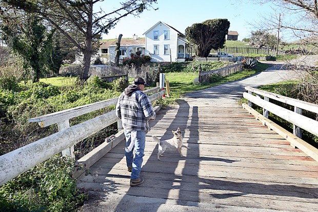 Roland 'Beaver' Edwards walks over Majors Creek, which runs through his Coastside Ranch property, back to his home overlooking his family's Red, White and Blue Beach. Edwards and his siblings are asking $35 million for the 175-acre ranch. (Dan Coyro/Santa Cruz Sentinel)