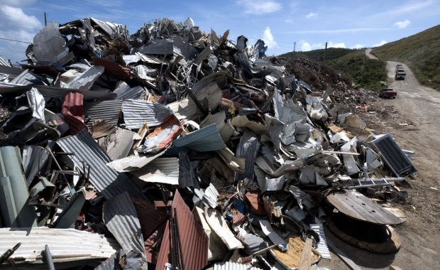 Piles of debris are seen in St. Thomas, U. S. Virgin Islands, on January22, 2018. Disposing of tons of roofing materials and vegetal debris is a significant challange for the islands. Environmentalists opposed an Army Corps of Engineers plan to burn debris. MUST CREDIT: Washington Post photo by Bonnie Jo Mount