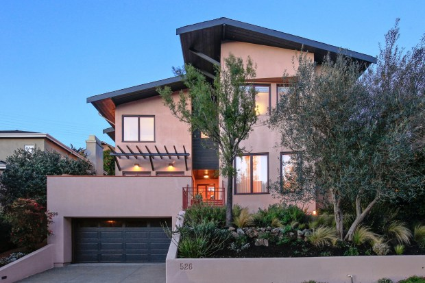 This home features elegant architectural shapes, volume, and texture designed to impart harmony and flow.