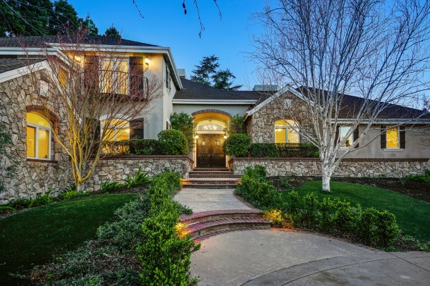 This 5,700-square-foot gated French country estate at 2698 Caballo Ranchero is surrounded by captivating outdoor environments.
