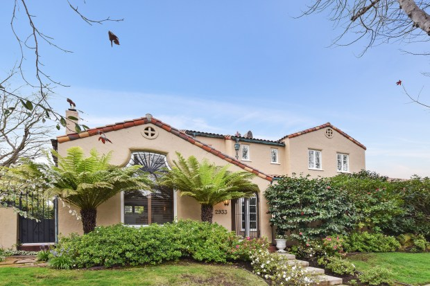 This Mediterranean homes features three bedrooms, three bathrooms and an impeccably maintained brick paved backyard.