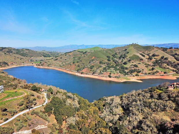 The home offers incredible views of Chesbro Lake and distant rolling hills.