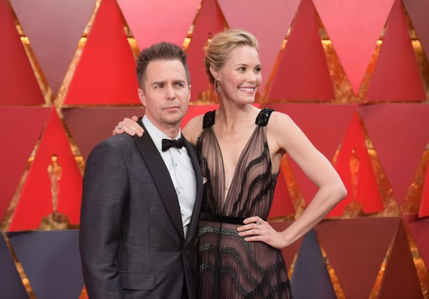 Sam Rockwell, left, and Leslie Bibb arrive at the Oscars on Sunday, March 4, 2018, at the Dolby Theatre in Los Angeles. (Photo by Richard Shotwell/Invision/AP)