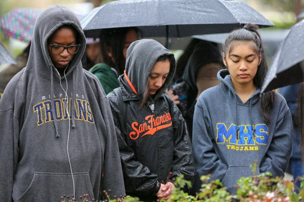 Milpitas High School students stand in silence in the rain outside of theMilpitas Police Department on Wednesday, March 14, 2018, as part of a 17-minute moment of silence to honor the victims of the shooting at Marjory Stoneman Douglas High School in Parkland, Florida last month. Hundreds of students from Milpitas High walked out of class and to the department to bring attention to the issue of school safety and call for tighter restrictions on guns. (Joseph Geha/Bay Area News Group)