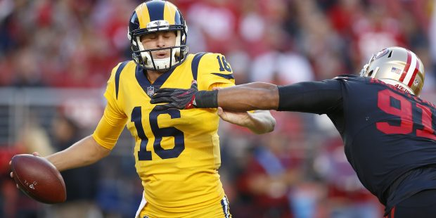 Los Angeles Rams starting quarterback Jared Goff (16) avoids a sack against San Francisco 49ers' Arik Armstead (91) in the first quarter of their NFL game at Levi's Stadium in Santa Clara, Calif., on Thursday, September 21, 2017. (Nhat V. Meyer/Bay Area News Group)