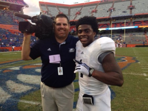 Frank Sulkowski, left, a longtime sports anchor in Savannah, Georgia, poseswith Jerick McKinnon not long after the Georgia Southern running back shocked Florida with a game-winning touchdown in 2013. (Courtesy: WJCL-TV)
