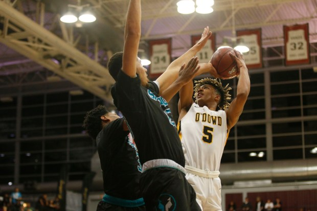 Bishop O'Dowd's Naseem Gaskin (5) tries to shoot over a pair of Sheldon defenders in the first quarter of the CIF NorCal Open Division boys championship game at Leavey Center in Santa Clara, Calif. on Saturday, March 17, 2018. (Randy Vazquez/ Bay Area News Group)