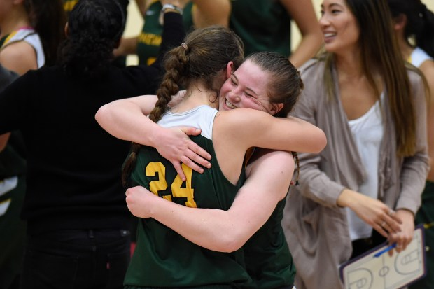 Pinewood's Hannah Jump (24) hugs teammate Klara Astrom (11) as they celebrate defeating Archbishop Mitty during their CIF Northern California Open Division girls final at Santa Clara University in Santa Clara, Calif., on Saturday, March 17, 2018. Pinewood defeated Archbishop Mitty 78-67 in triple overtime. (Jose Carlos Fajardo/Bay Area News Group)