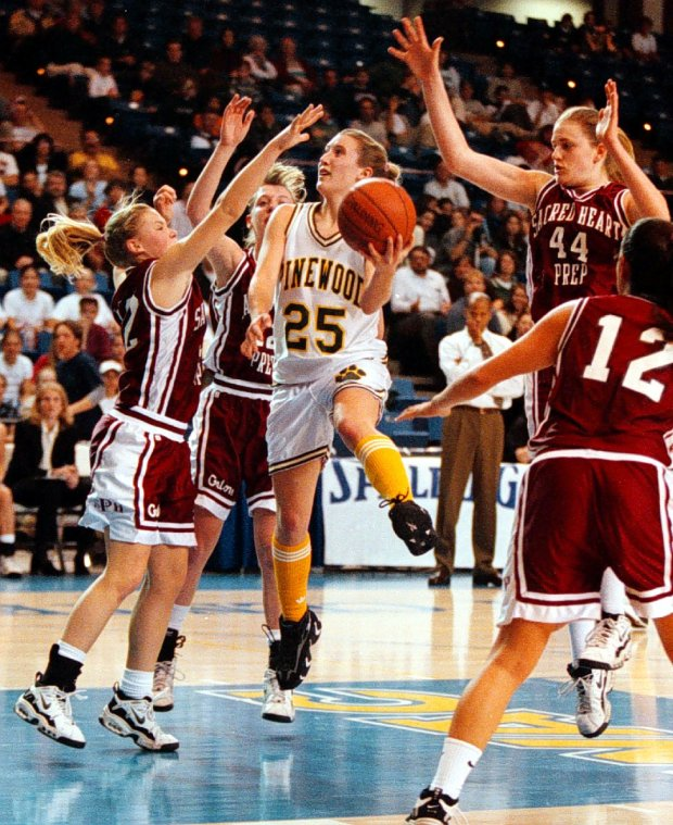 John Green 3/6/98 SMC Times SportsThe Sacred Heart defense could not stop Pinwood's Lauren Smith-Hams on this drive to the bucket in the first half of their CCS playoff game Friday afternoon at the San Jose State Event Center.