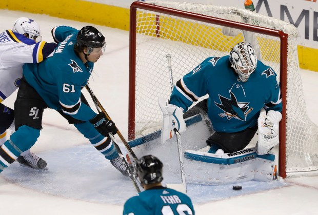San Jose Sharks goaltender Martin Jones (31) blocks a shot against the St. Louis Blues in front of San Jose Sharks' Justin Braun (61) in the second period at SAP Center in San Jose, Calif., on Thursday, March 8, 2018. (Nhat V. Meyer/Bay Area News Group)
