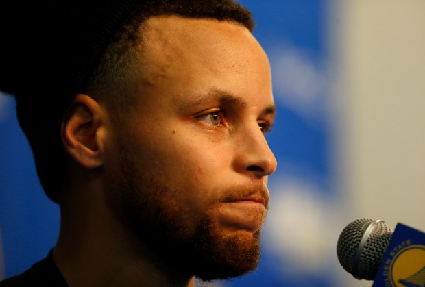 Golden State Warriors' Stephen Curry (30) talks about his injury during a press conference before the Warriors game against the Utah Jazz at Oracle Arena in Oakland, Calif., on Sunday, March 25, 2018. (Nhat V. Meyer/Bay Area News Group)