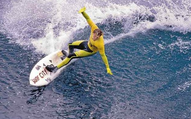 Steamer Lane regular and local enforcer Vince Collier carves a line with his board scrawled with 'Surf City' in the first round of the 1989 O'Neill Coldwater Classic. Collier died of a heart attack recently in Mexico. (Dan Coyro -- Santa Cruz Sentinel file)
