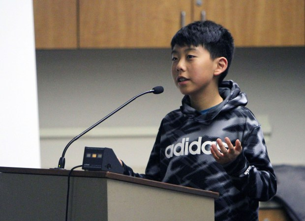 Lucas Guan, a seventh-grader at Jordan Middle School, speaks in favor of geographical names being chosen for his school and Terman Middle School during the school board meeting. (Brad Shirakawa)