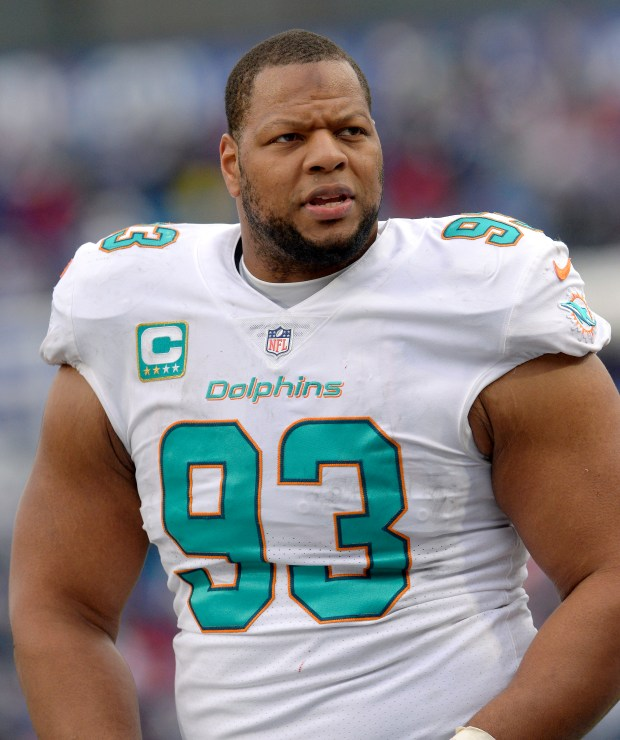 FILE - In this Dec. 17, 2017, file photo, Miami Dolphins defensive tackle Ndamukong Suh (93) looks on from the sideline during the first half of an NFL football game against the Buffalo Bills, in Orchard Park, N.Y. The Miami Dolphins appear ready to move on without their defensive anchor. Miami is discussing releasing five-time Pro Bowl tackle Ndamukong Suh when the NFL's new year begins Wednesday, a person familiar with the situation said Monday, March 12, 2018. The person said nothing has been finalized, and confirmed the conversations to The Associated Press on condition of anonymity because the Dolphins have not commented. (AP Photo/Adrian Kraus, File)