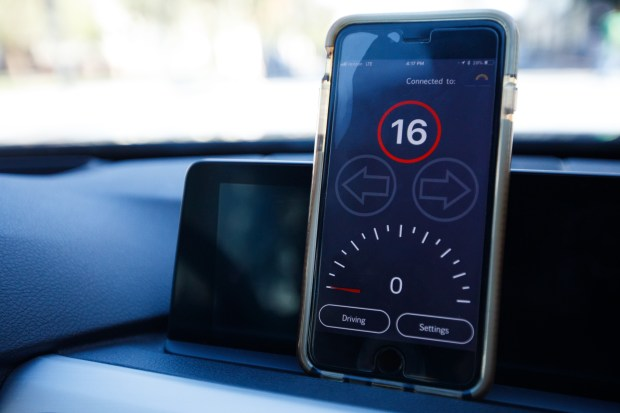 While stopped at a red light, Connected Signals' app displays how long until the light changes during a demonstration on March 28, 2018 in downtown, San Jose. (Dai Sugano/Bay Area News Group)