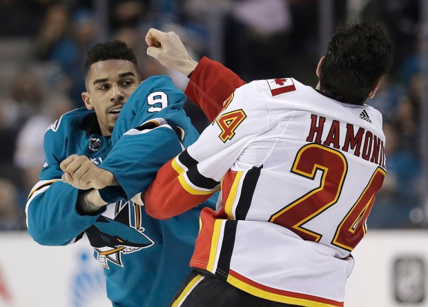 San Jose Sharks' Evander Kane (9) fights with Travis Hamonic (24) during the third period of an NHL hockey game Saturday, March 24, 2018, in San Jose, Calif. (AP Photo/Marcio Jose Sanchez)