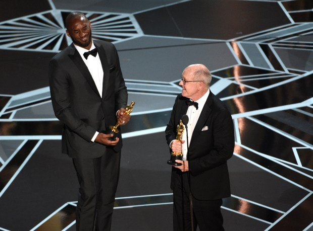 """Kobe Bryant, left, and Glen Keane accept the award for best animated short for """"Dear Basketball"""" at the Oscars on Sunday, March 4, 2018, at the Dolby Theatre in Los Angeles. (Photo by Chris Pizzello/Invision/AP)"""