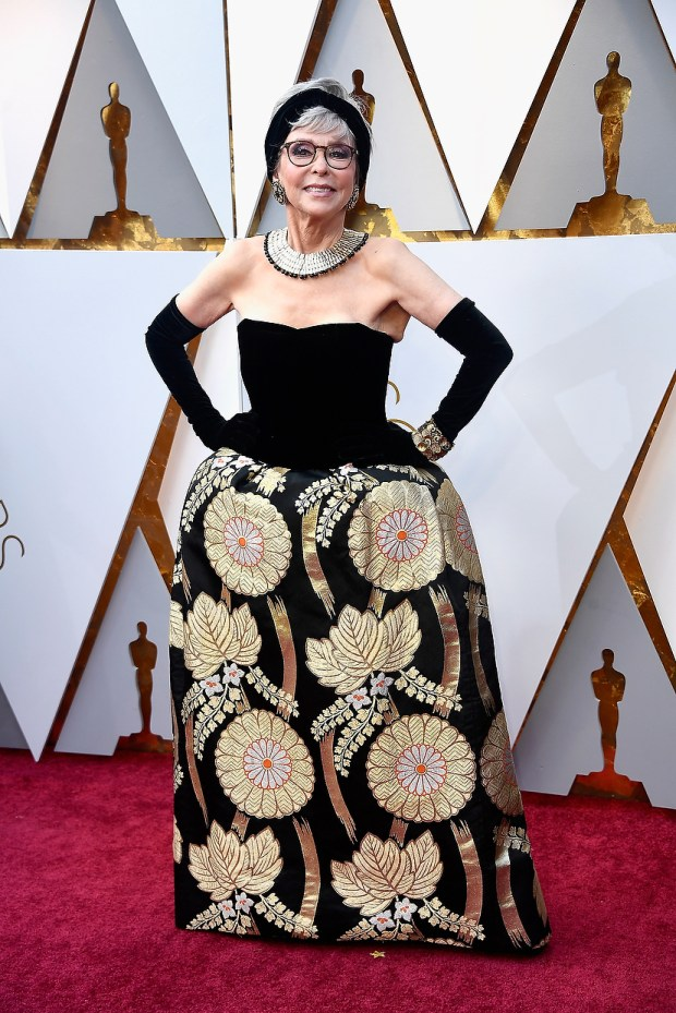Rita Moreno's Oscar dress from 1962 was a miss and it hasn't gotten better with age as she re-wore it for the 90th Annual Academy Awards on March 4, 2018 in Hollywood. (Photo by Frazer Harrison/Getty Images)