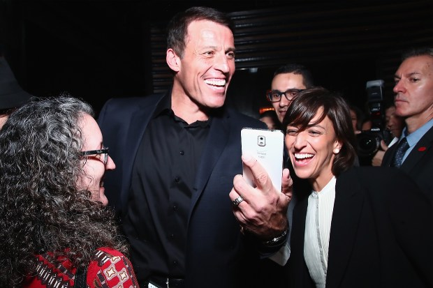 "Author Tony Robbins (C) and guests attend Tony Robbins' Birthday celebration and book launch of ""UNSHAKEABLE"" presented by DuJour, Gilt and JetSmarter at PH-D Rooftop Lounge at Dream Downtown on February 27, 2017 in New York City. (Photo by Astrid Stawiarz/Getty Images for DuJour)"