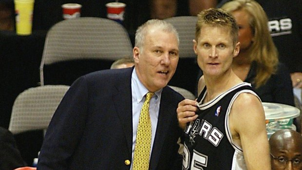 Head coach Gregg Popovich, left, and Steve Kerr of the San Antonio Spurs celebrates after game six of the NBA Western Conference Finals on May 29, 2003, at the American Airlines Center in Dallas, Texas. Kerr made four of four three-point baskets to lead the Spurs. The Spurs won the game 90-78 to win the best-of-seven game series 4-2 to defeat the Dallas Mavericks. (James Nielsen/AFP/Getty Images)