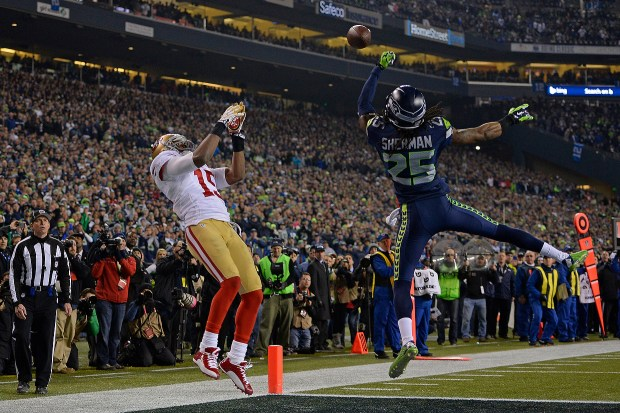 Seattle Seahawks' Richard Sherman (25) knocks down a pass intended for San Francisco 49ers' Michael Crabtree (15) in the end zone in the fourth quarter of their NFC Championship NFL Game at CenturyLink Field in Seattle, Wash., on Sunday, Jan. 19, 2014. Seattle Seahawks' Malcolm Smith would intercept the pass in the end zone. Seattle defeated San Francisco, 23-17. (Jose Carlos Fajardo/Bay Area News Group)