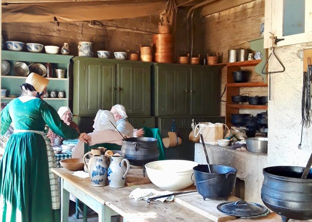 Docents work in the kitchen of Sutter's Fort in Sacramento, where livinghistory days are held once a month. (Courtesy Angela Hill)