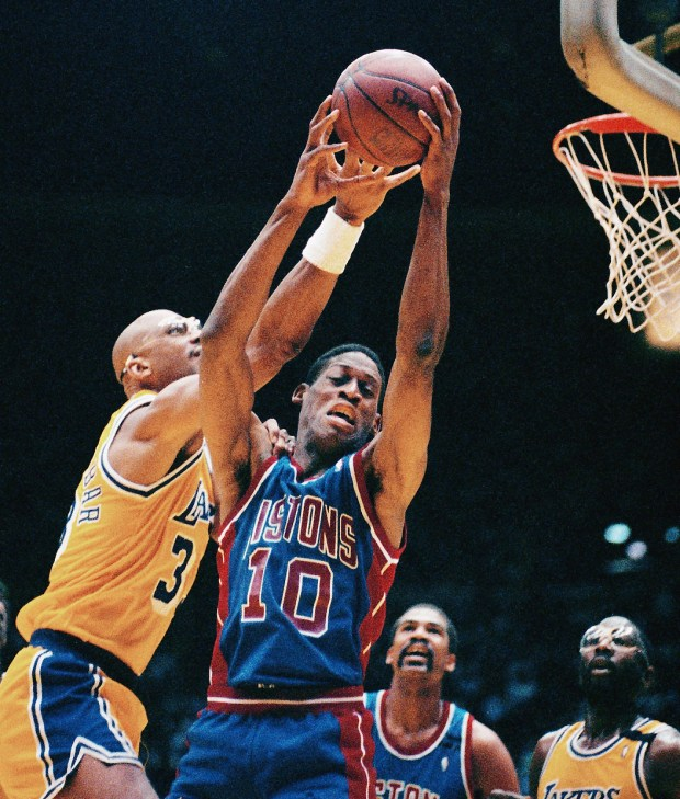 Dennis Rodman (10) of Detroit Pistons grabs a rebound away from Los Angeles Lakers' Kareem Abdul-Jabbar, left, during Game 3 of the NBA Finals in Los Angeles on June 11, 1989. (AP Photo / Bob Galbraith)