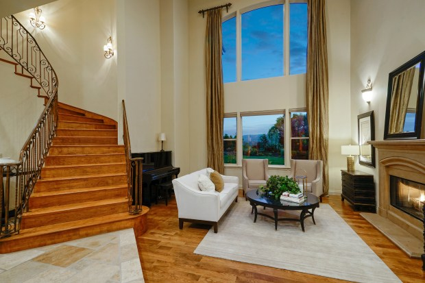 Stunning views, a grand fireplace and gorgeous floors provide a comfortable spot to chat and relax.