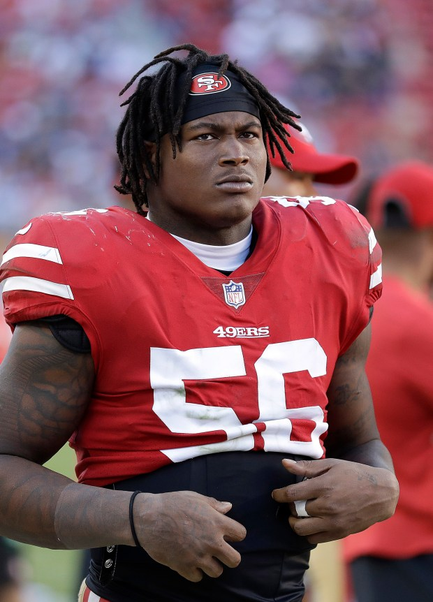 In this Oct. 22, 2017 file photo, San Francisco 49ers linebacker Reuben Foster (56) stands on the sideline during the second half of an NFL football game against the Dallas Cowboys in Santa Clara, Calif. (AP Photo/Marcio Jose Sanchez, File)