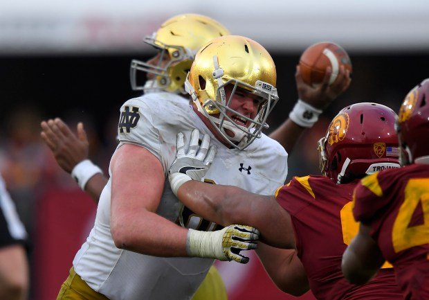 Notre Dame offensive lineman Mike McGlinchey, left, tries to hold back Southern California defensive tackle Stevie Tu'ikolovatu during the second half of an NCAA college football game, Saturday, Nov. 26, 2016, in Los Angeles. USC won 45-27. (AP Photo/Mark J. Terrill)