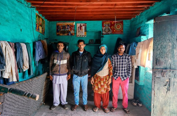 Om Pati is the mother of seven sons, including from left, Sandeep, Sanjayand Suresh. MUST CREDIT: Photo for The Washington Post by Poras Chaudhary
